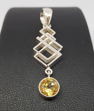 Silver pendant with citrine coloured gemstone