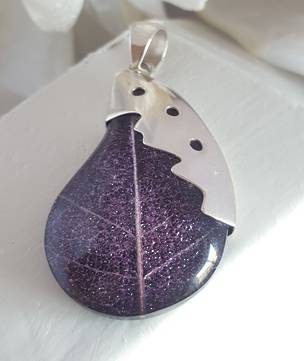 Deep purple pendant made from skeleton leaf