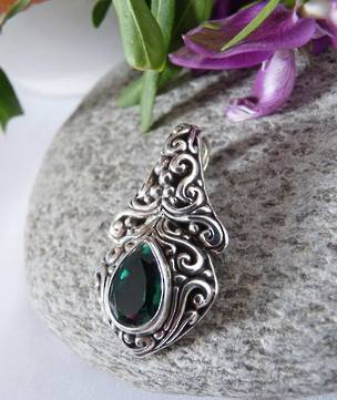 Green quartz pendant set in heavy decorated silver