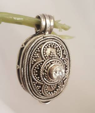 Oval filigree silver prayer or wish box pendant