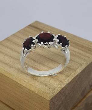 Silver ring with three natural garnet gemstones