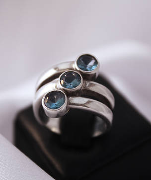Three Stone Blue Topaz Spiral Ring
