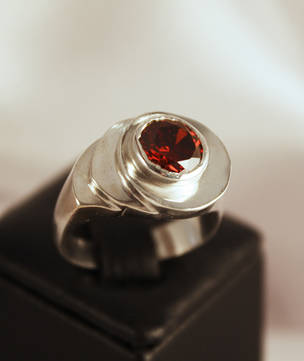 Solid sterling silver facet cut garnet ring
