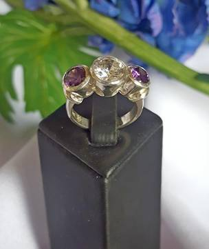 925 silver ring with three deep purple stones