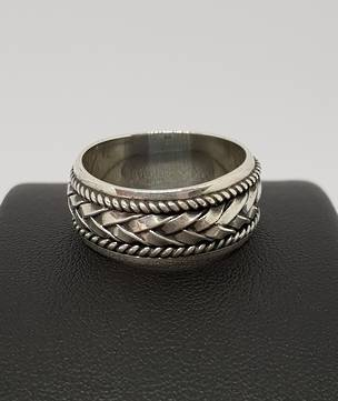 Silver ring with plaited detail