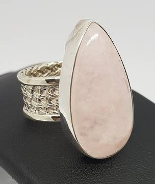 Romantic rose quartz ring with wide woven silver band