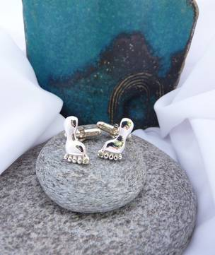 Sterling silver cufflinks in the shape of a foot