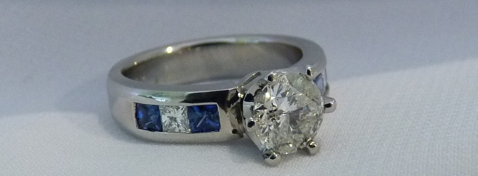 handmade sapphire and diamond platinum engagement ring SilverStone jewellery