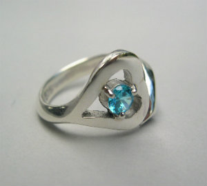 silver heart ring with blue topaz