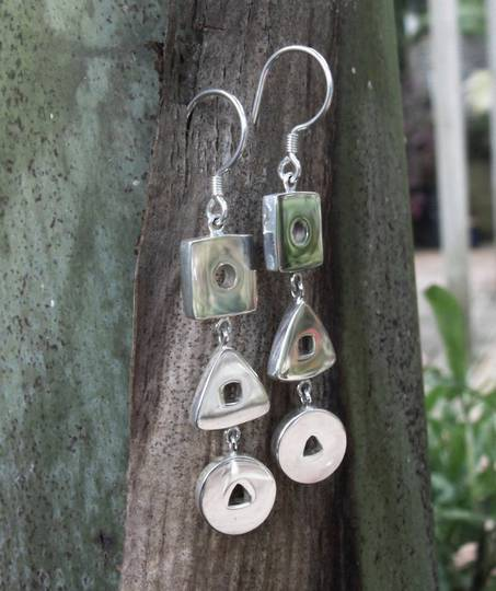 Quirky design, three piece silver earrings