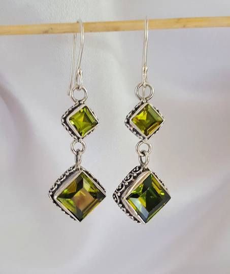 Luxurious silver peridot earrings with filigree detail