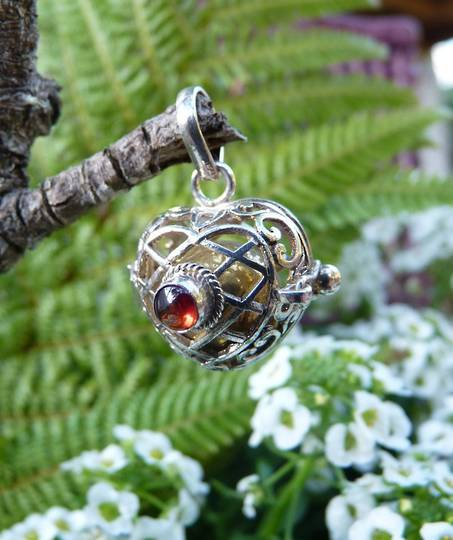 Filigree silver, harmony ball pendant with garnet