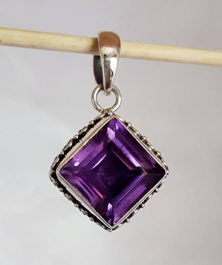 Princess cut amethyst pendant in silver frame