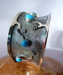 Sterling silver cuff bangle with turquoise gemstones