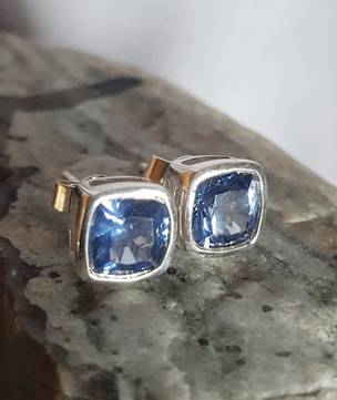 Sterling silver synthetic sapphire stud earrings