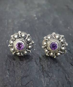 Filigree stud earrings with deep purple gemstone