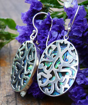 Paua shell silver earrings - ornate carved front