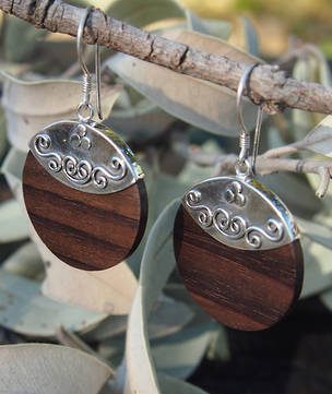 Polished wooden earrings with silver hook