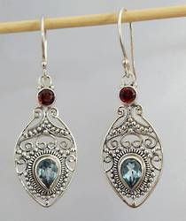 Glamour packed blue topaz and garnet earrings