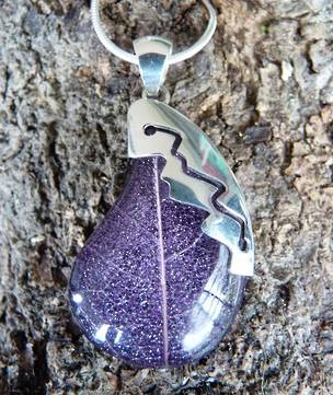 Purple skeleton leaf pendant with silver detail