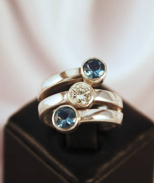 Three Stone Spiral Ring with Blue Topaz