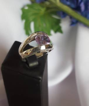 High set, sterling silver ring with amethyst