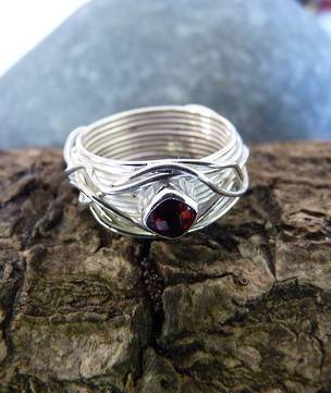 Wide silver band with sparkling garnet set in the top